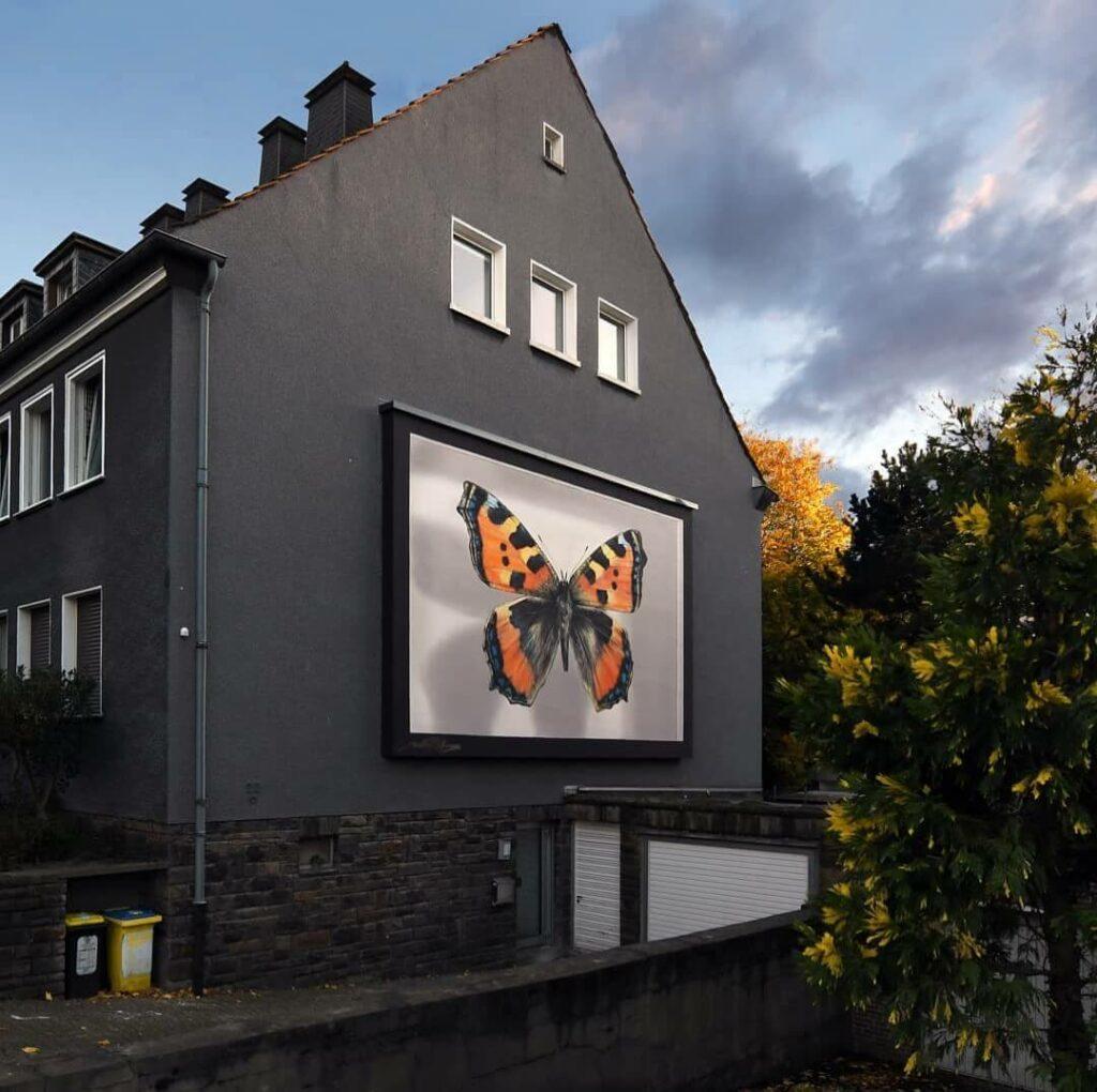 Der Algaispilot Dortmund, Germany | Butterfly mural by street artist Mantra