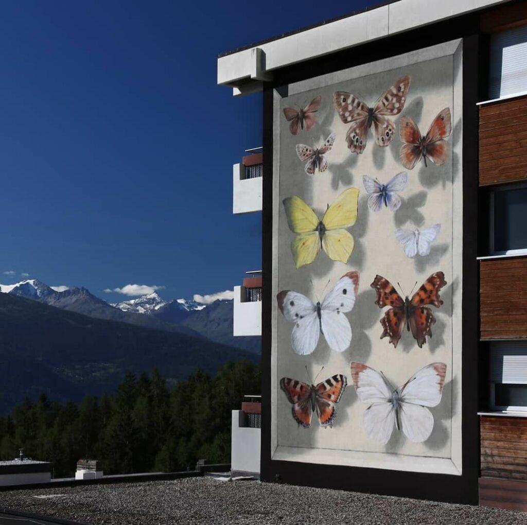 La collection du Valais, Cransmontana, Switzerland | Butterfly mural by street artist Mantra