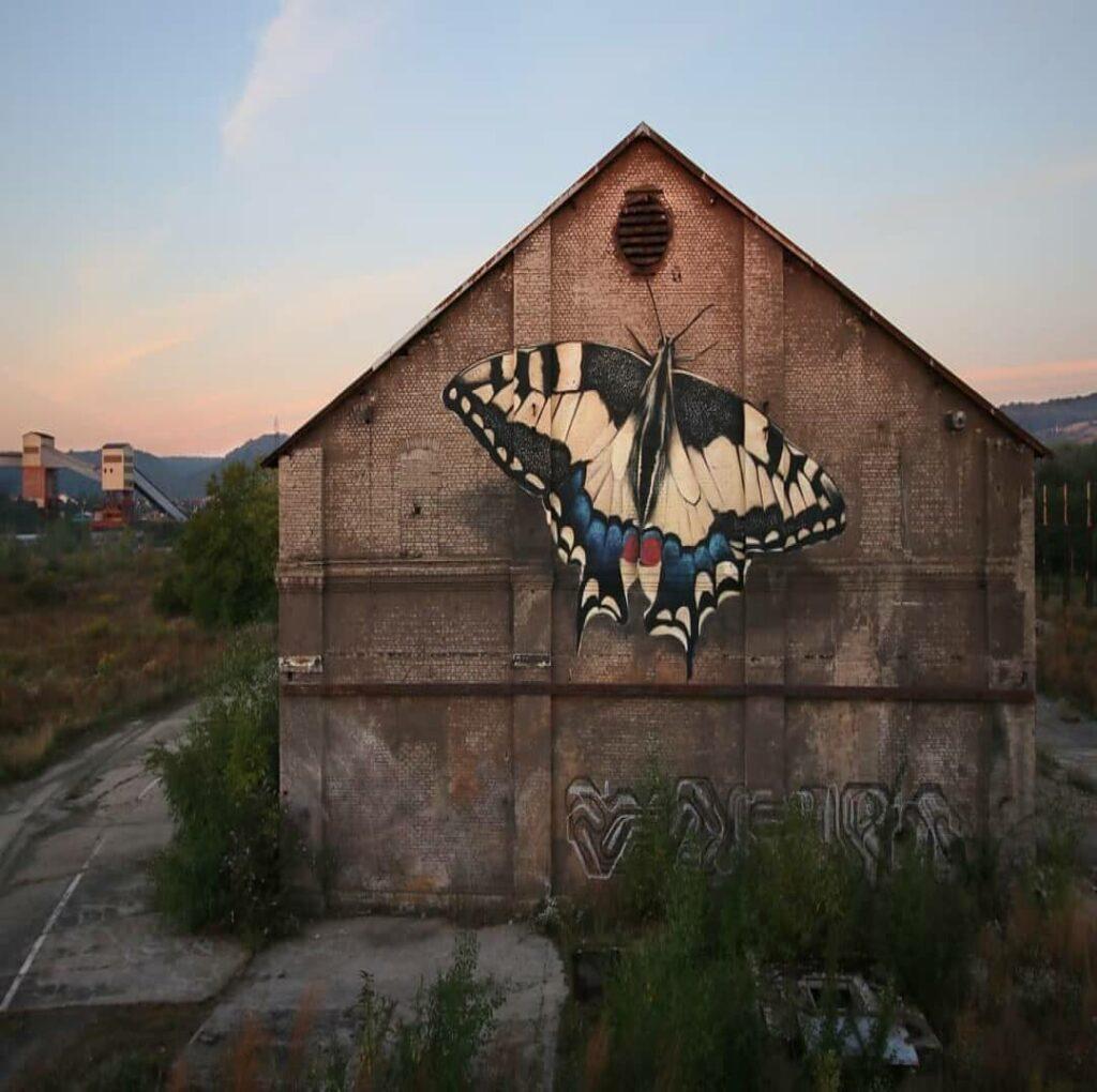 La renaissance du Machaon, Rombas, France | Butterfly mural by street artist Mantra