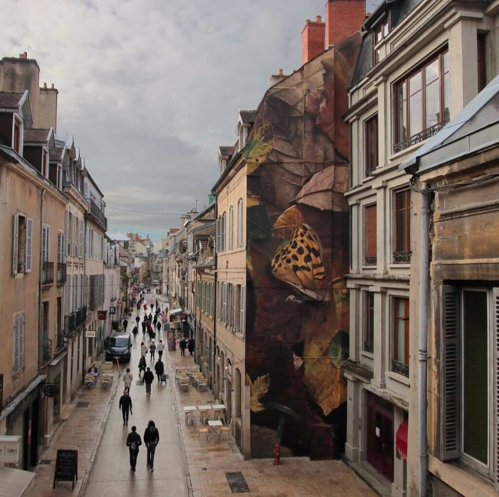 Memoire d'automne, Dijon, France | Butterfly mural by street artist Mantra
