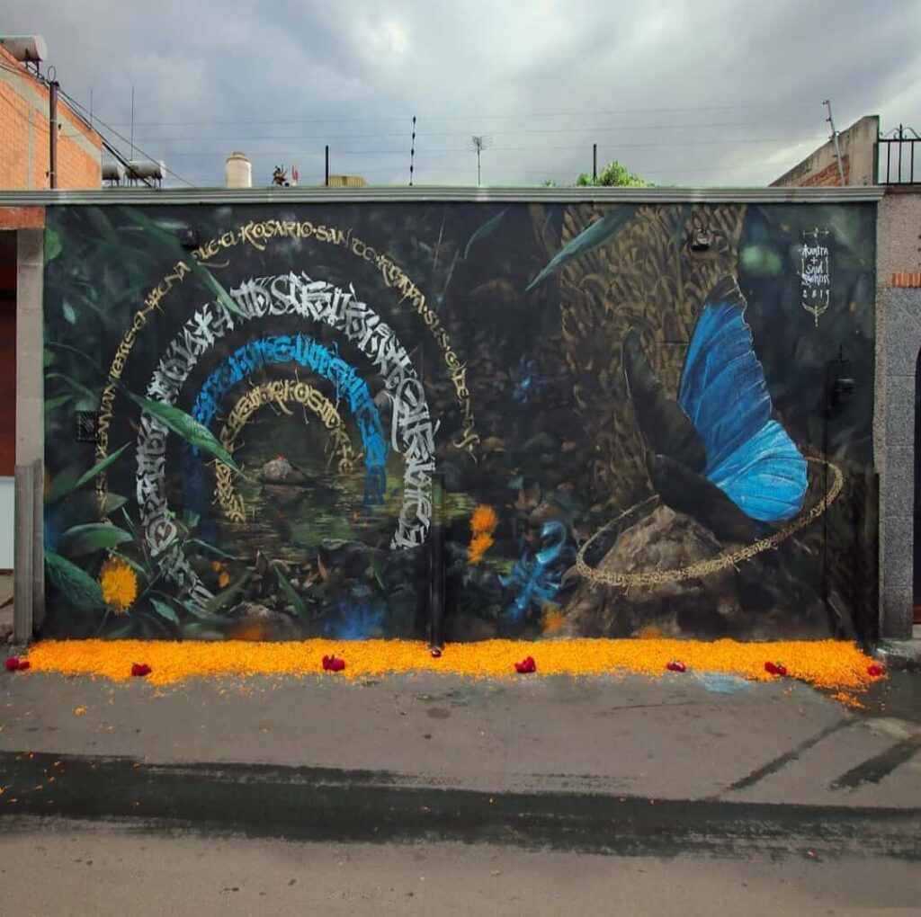 Ofrenda del los Animeros, San Juan de Tihuaca, Mexico | Butterfly mural by street artist Mantra
