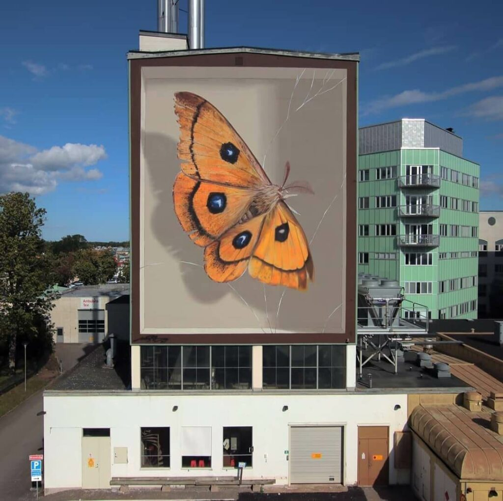 The Emperor Tau, Vastervik, Sweden | Butterfly mural by street artist Mantra